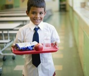 Boy holding tray in cafe_300.jpg
